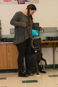 Teed advocate standing with service dog