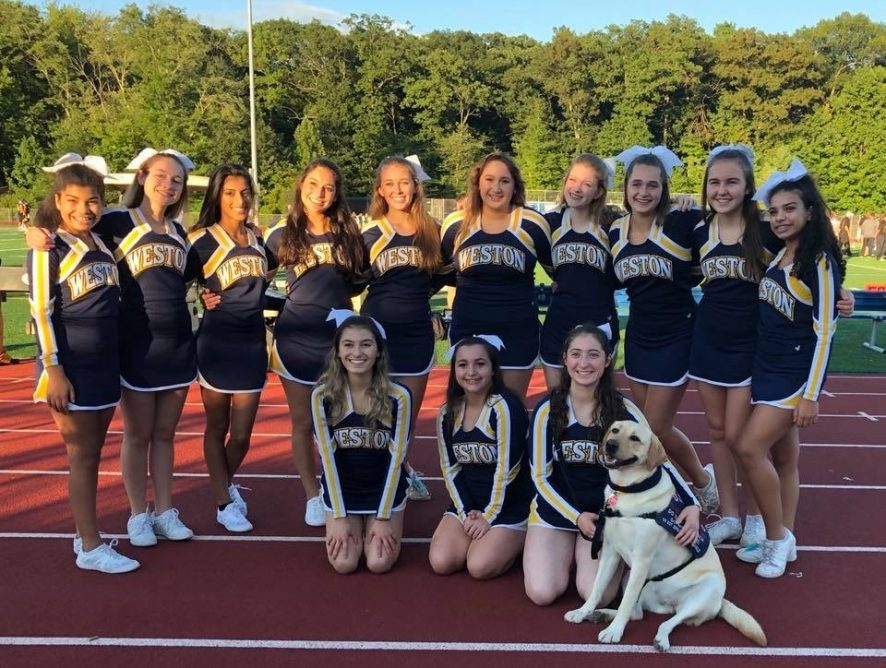 community service dog with cheerleaders